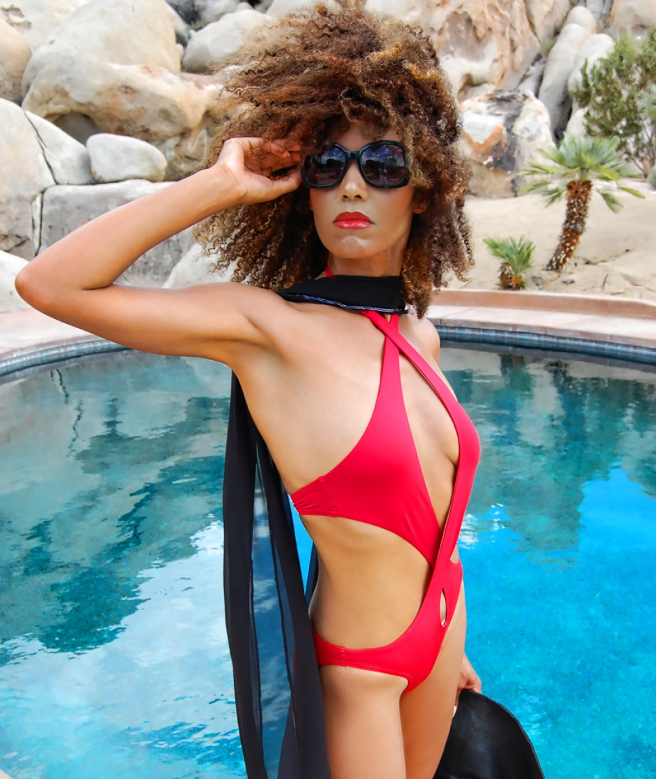 Ndoema lounges pool side in Chloe sunglasses, BCBG Max Azria gladiator sandals and a red cutout swimsuit