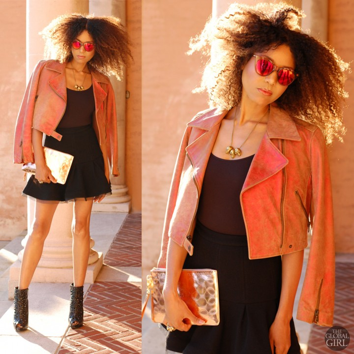 The Global Girl Daily Style: Ndoema sports a moto jacket by Donald J Pliner with Alexander Wang skater mini skirt, Le Specs red mirrored sunglasses, Report Signature jeweled booties, a gold triple skull necklace and George Gina & Lucy copper metallic clutch.