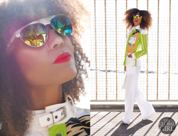 The Global Girl Daily Style: Ndoema rocks a printed jacket by Custo Barcelona with yellow and green mirrored white sunglasses, white python clutch bag by Son Jung Wan and Cynthia Vincent white wide leg pants.