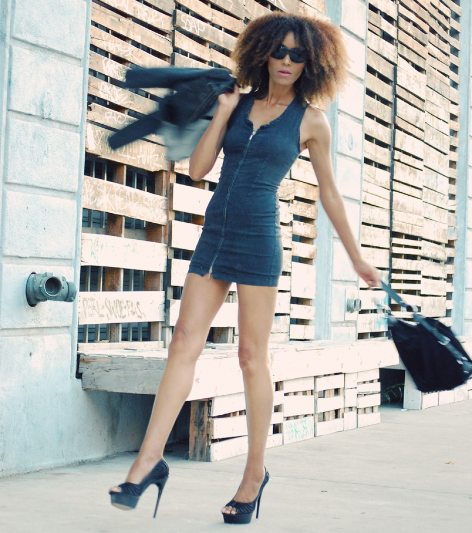 Ndoema wears a Diesel denim dress, Dolce And Gabbana Sunglasses and L.A.M.B. platform pumps