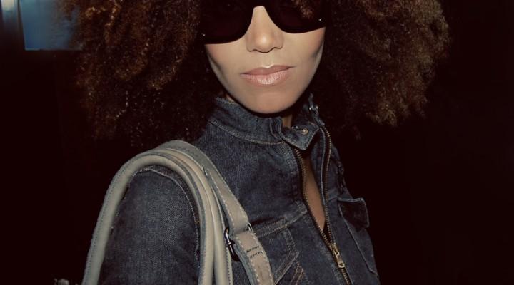 Ndoema wears Chloé sunglasses, Dolce and Gabbana cropped denim jacket, G-Star Raw skinny jeans and Linea Pelle leather bag