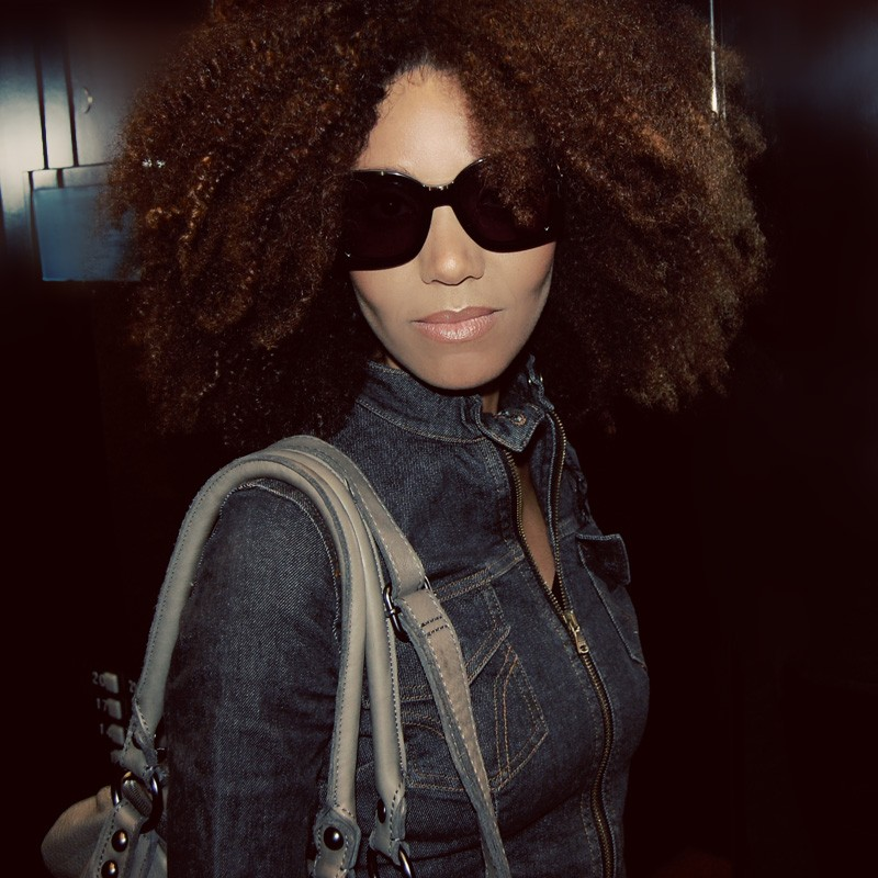 Ndoema wears Chloé sunglasses, Dolce and Gabbana cropped denim jacket, G-Star Raw skinny jeans and Linea Pelle leather bag