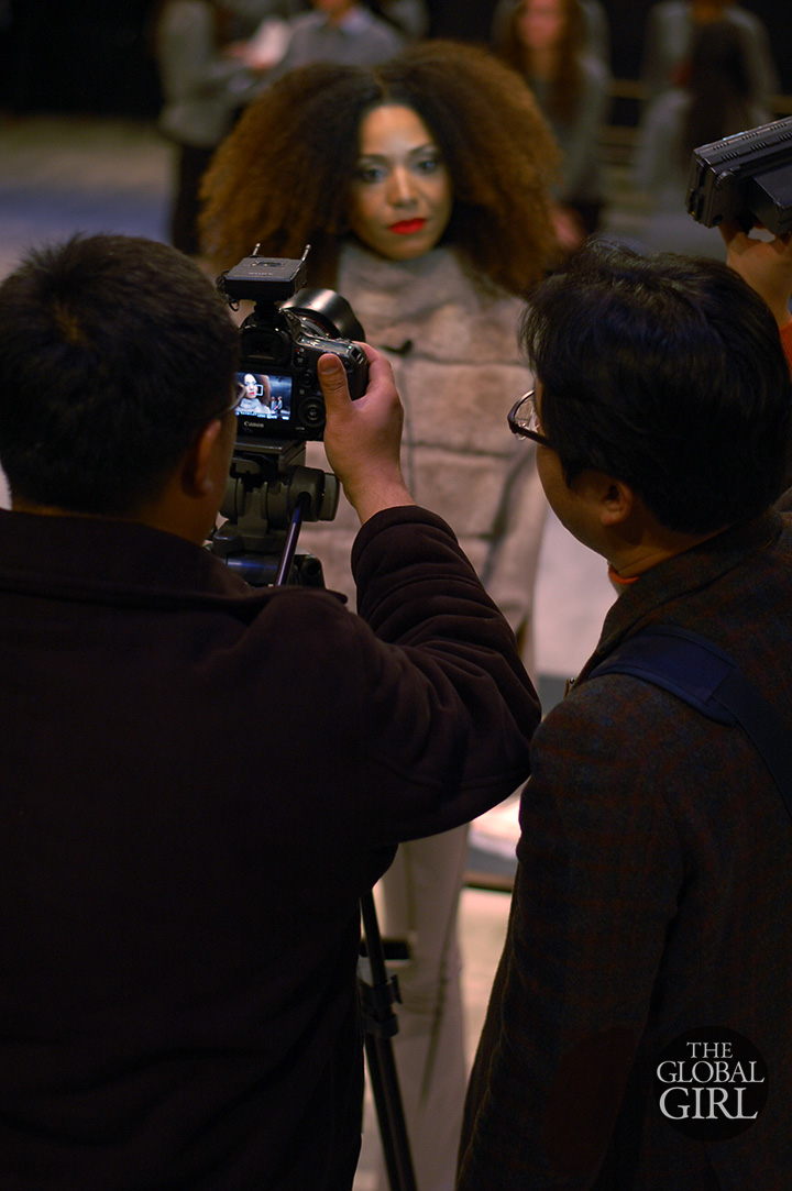 Front Row with The Global Girl at New York Fashion Week: Ndoema interviewed post show by Korean TV Network Arirang at Son Jung Wan Fall Winter 2014 Runway Collection