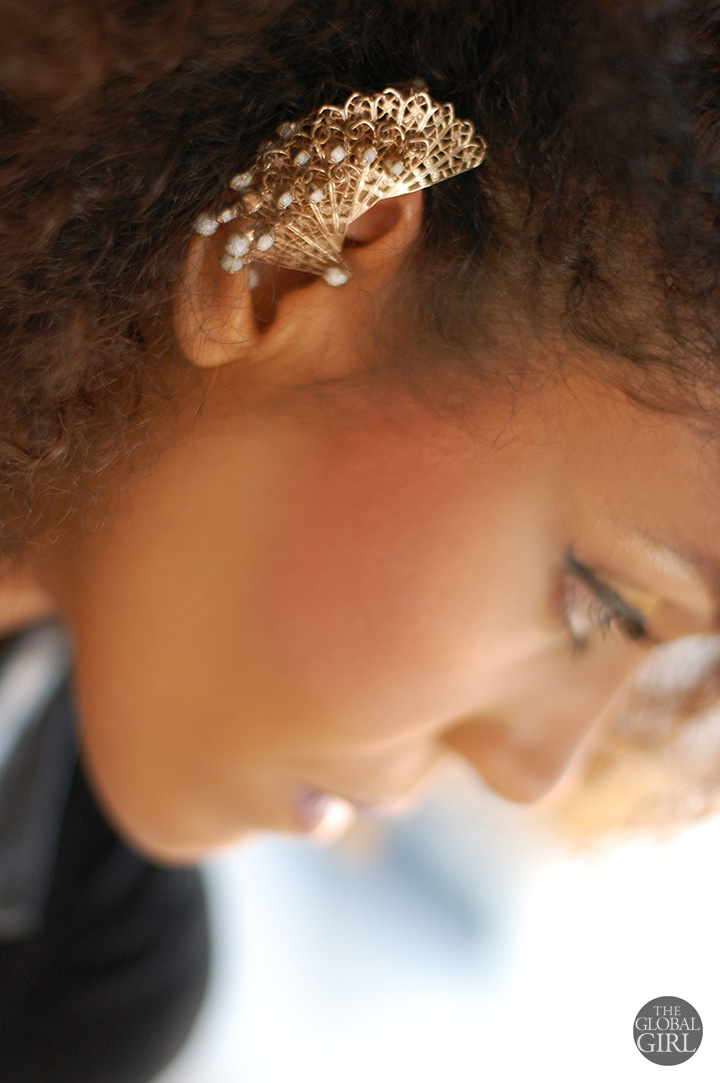 The Global Girl Daily Style: Ndoema rocks her statement jewelry with a gold vintage fan ear cuff.
