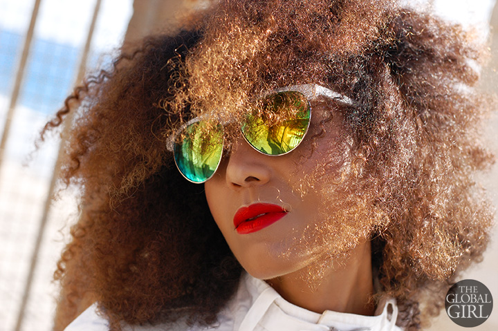 The Global Girl Daily Style: Ndoema rocks a bold yellow and green mirrored white sunglasses.
