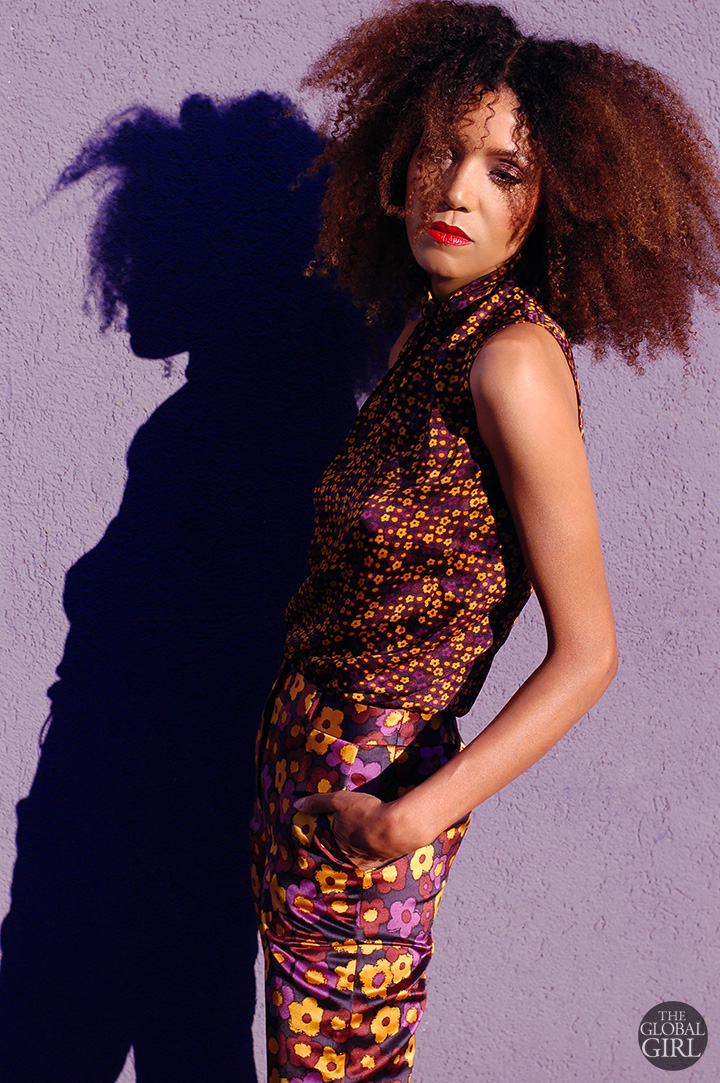 The Global Girl: Ndoema rocks a head-to-toe floral print look with her trademark natural curls and bold red lip.