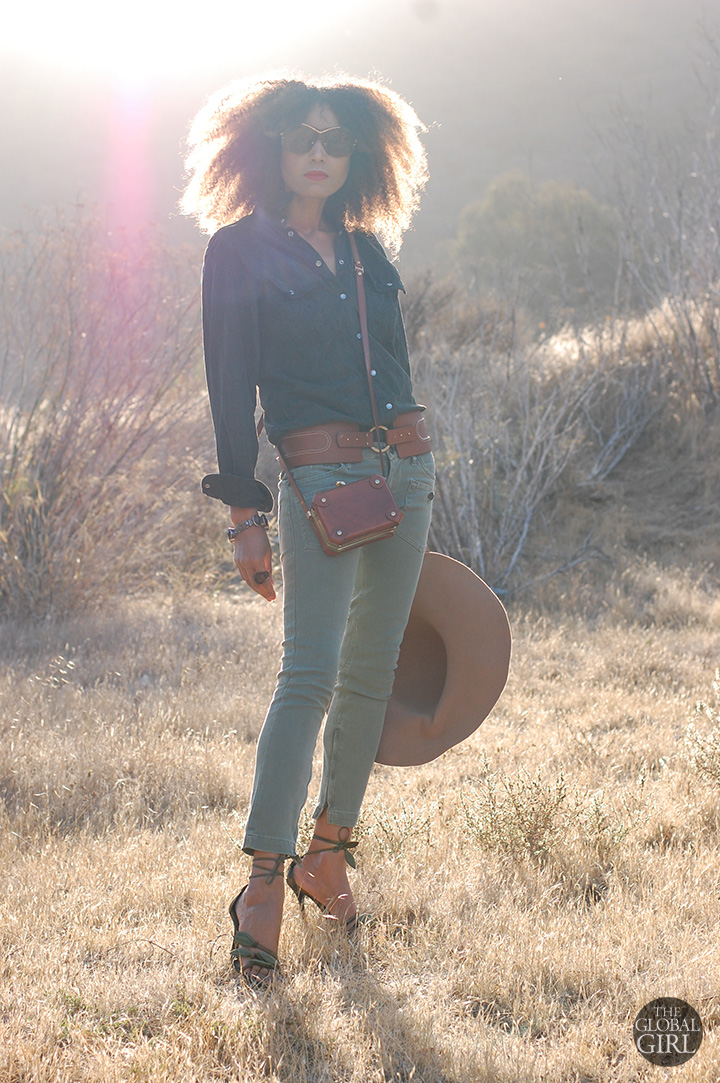The Global Girl Daily Style: Ndoema rocks khaki skinny cropped jeans by Miss Sixty with Valentino ankle tie leaf sandals, oversized monobrow shield sunglasses, vintage cross body mini leather bag, Adrienne Vittadini wide tan belt, vintage suede shirt and vintage floppy hat.