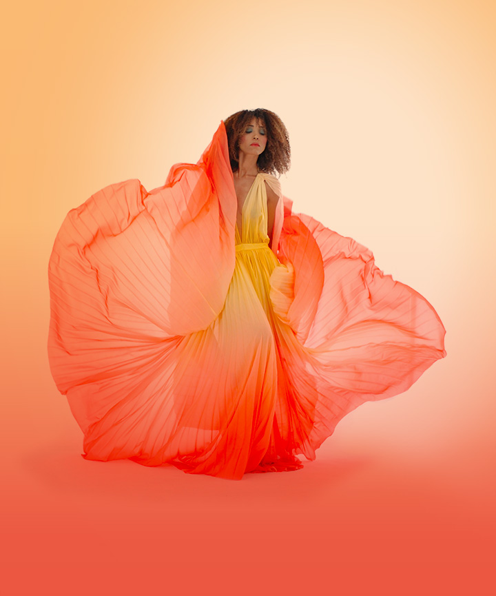 The Global Girl: Ndoema wears an ombre halter gown from Son Jung Wan Spring 2013 Collection and Versace pink suede sandals.