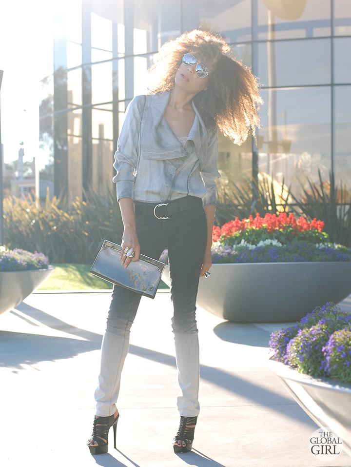 The Global Girl Daily Style: Ndoema sports ombre skinny jeans by Stella McCartney and Le Specs silver mirrored aviator sunglasses with ombre patent leather clutch by Banana Republic and LAMB platform sandals.
