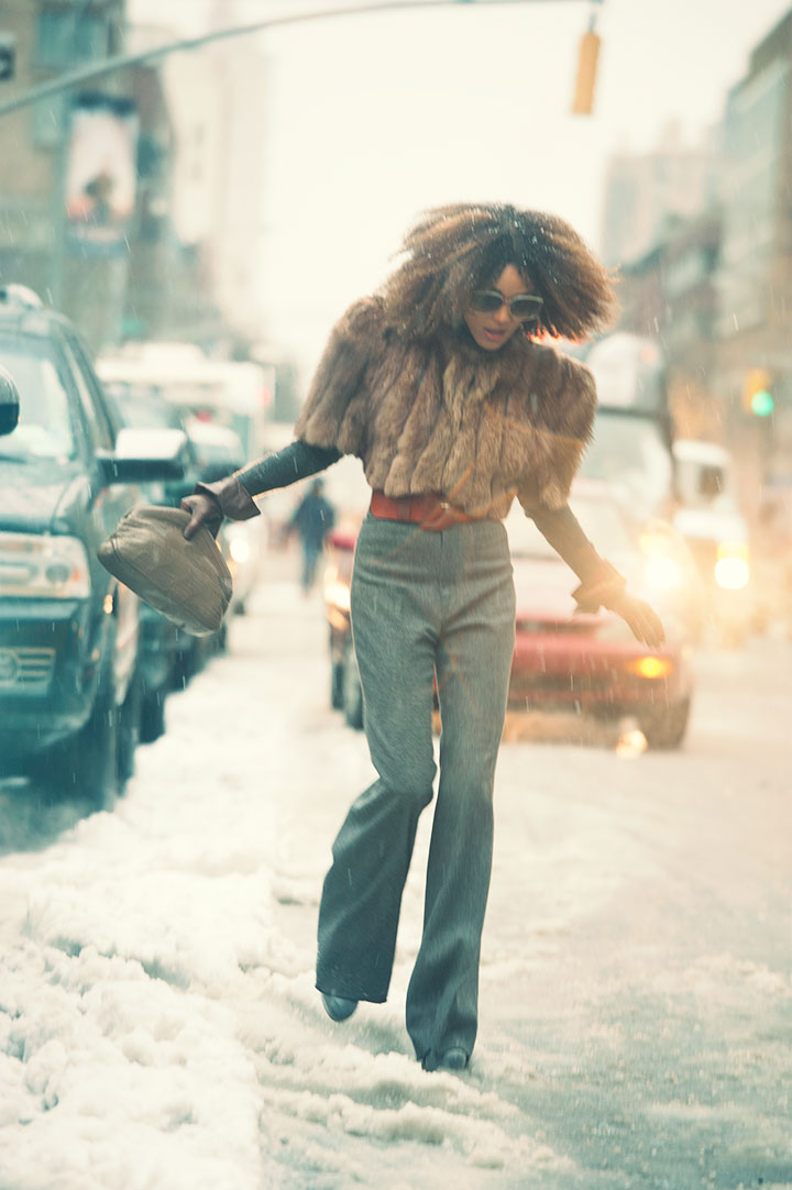 The Global Girl: Ndoema photographed by Paris-based photographer Kamel Lahmadi during New York Fashion Week. Ndoema sports head-to-toe vintage: seventies flared grey flannel pants, faux-fur cropped jacket, ruffle cuff leather gloves, camel leather clutch and oversized sunglasses from The Guise Archives.