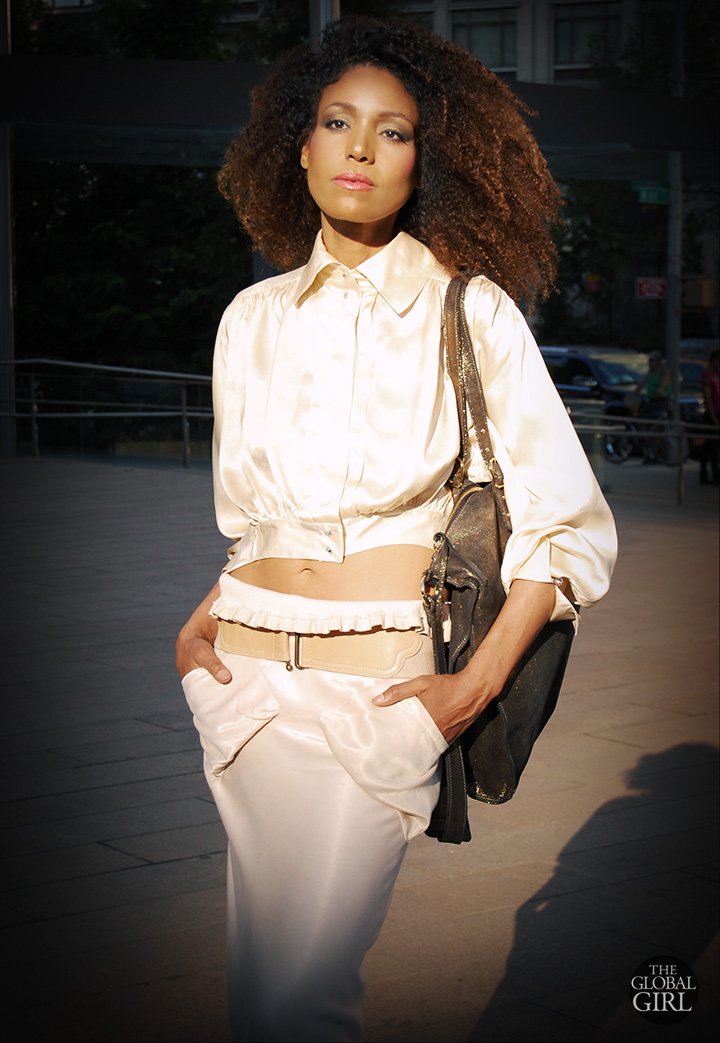 The Global Girl Daily Style: Ndoema sports an elegant exposed midriff look in all-white Rick Owens fishtail skirt and vintage crop top with gold Onna Ehrlich bag