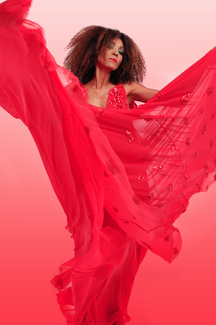 The Global Girl: Ndoema wears a beaded silk chiffon gown with plunging neckline from Son Jung Wan Spring 2013 Collection and Versace pink suede sandals.