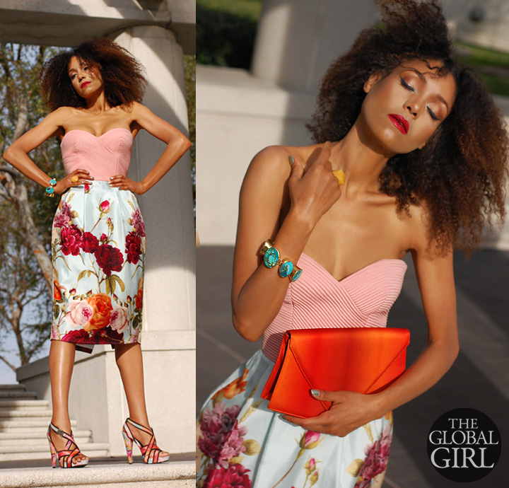 The Global Girl Fashion Editorials: Ndoema sports a romantic floral-print strapless bustier dress by Mimi Plange with a vintage satin orange geometric clutch, a custom turquoise and brass oversized bracelet and custom yellow agate oversized ring.