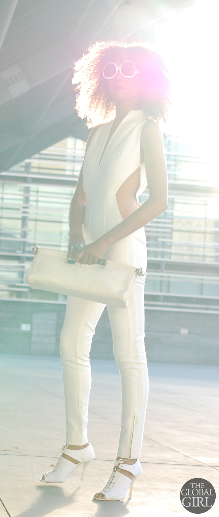 The Global Girl Fashion Editorials: Ndoema rocks the all-white look: cut out jumpsuit from Son Jung Wang Spring 2014 runway collection   White frame oversized sunglasses by Balenciaga   White cutout lace-up sandals by Helmut Lang   White leather bag by Prada.