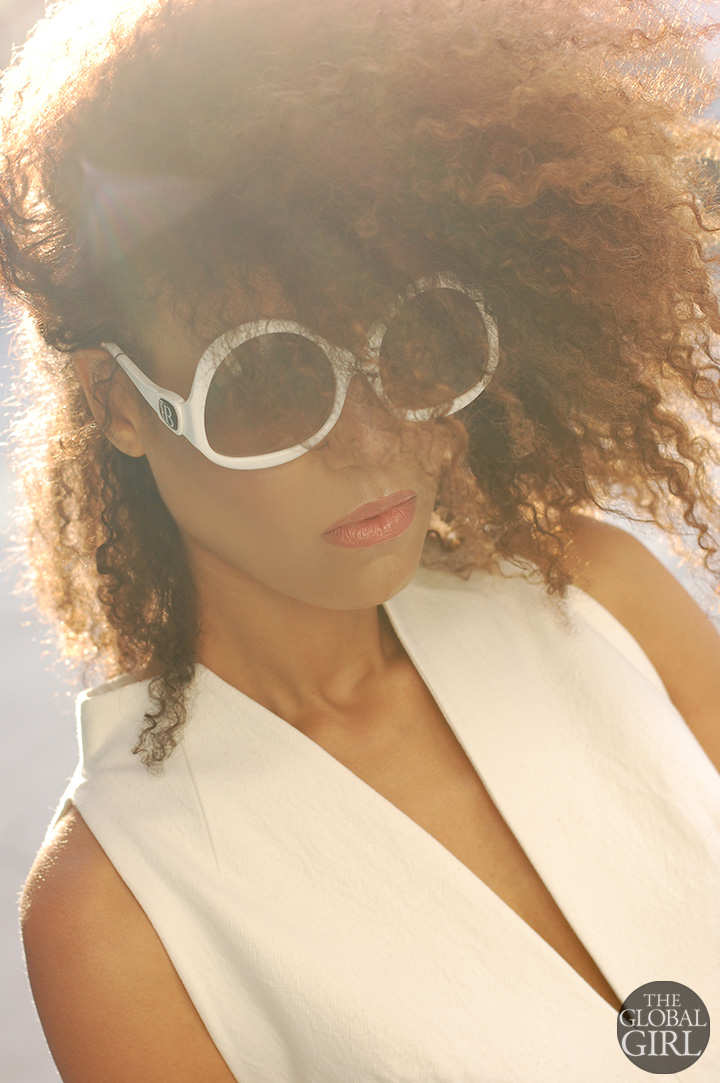 The Global Girl Fashion Editorials: Ndoema sports white frame oversized sunglasses by Balenciaga.