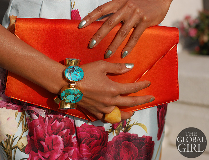 The Global Girl Fashion Editorials: Close-up on gorgeous vintage satin orange geometric clutch, custom turquoise and brass oversized bracelet and custom yellow agate oversized ring.