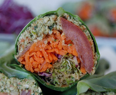 The Global Girl Raw Vegan Recipes: Falafel Burger Wrap in a collard creen Leaf with carrot, sprouts, tomato, red cabbage and red onion.