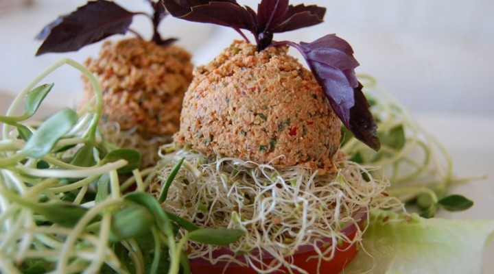 Raw Vegan Recipe: Juicy Raw Vegan Burger with walnuts, avocado, clover and sunflower sprouts in a tomato bun
