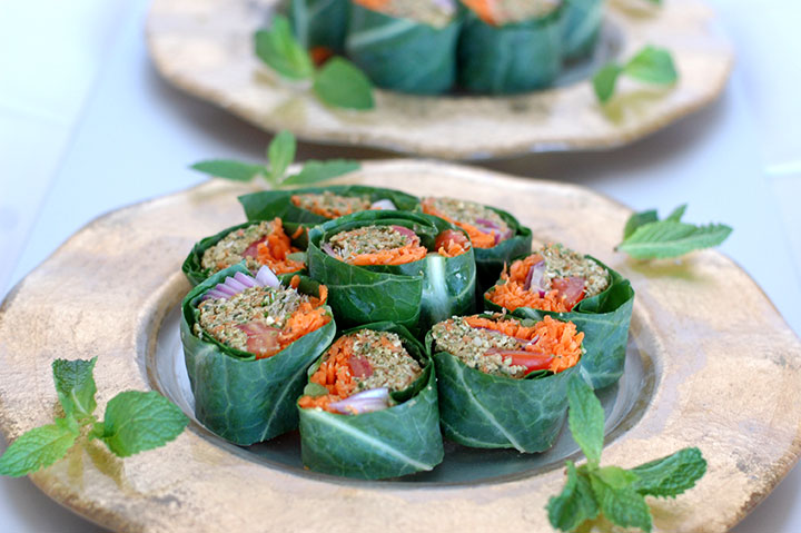 The Global Girl Raw Food Recipes: Raw Wrap with Pumpkin Seed & Mint Patty in a collard green leaf with tomato, shredded carrot, red onion and clover sprouts.