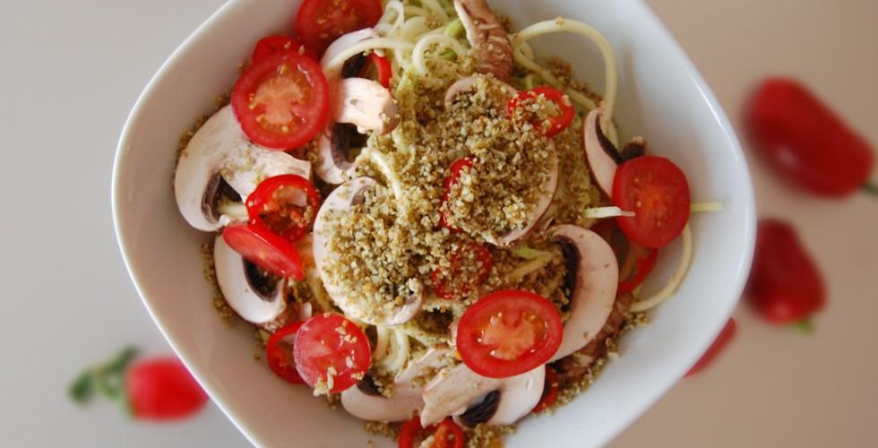 Pumpkin Seed Parmesan on zucchini pasta