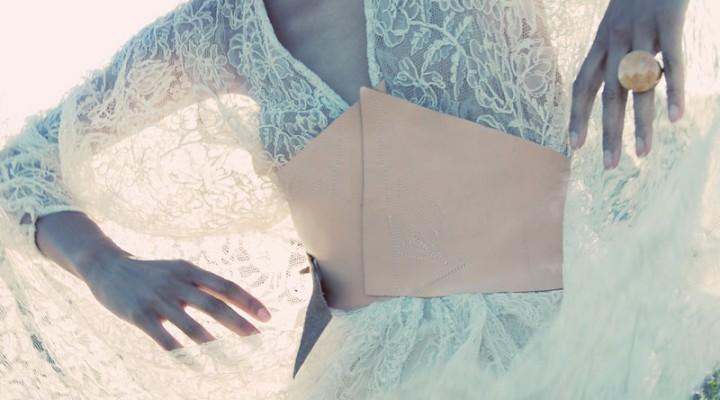 Ndoema wears a vintage lace dress and leather corset belt.