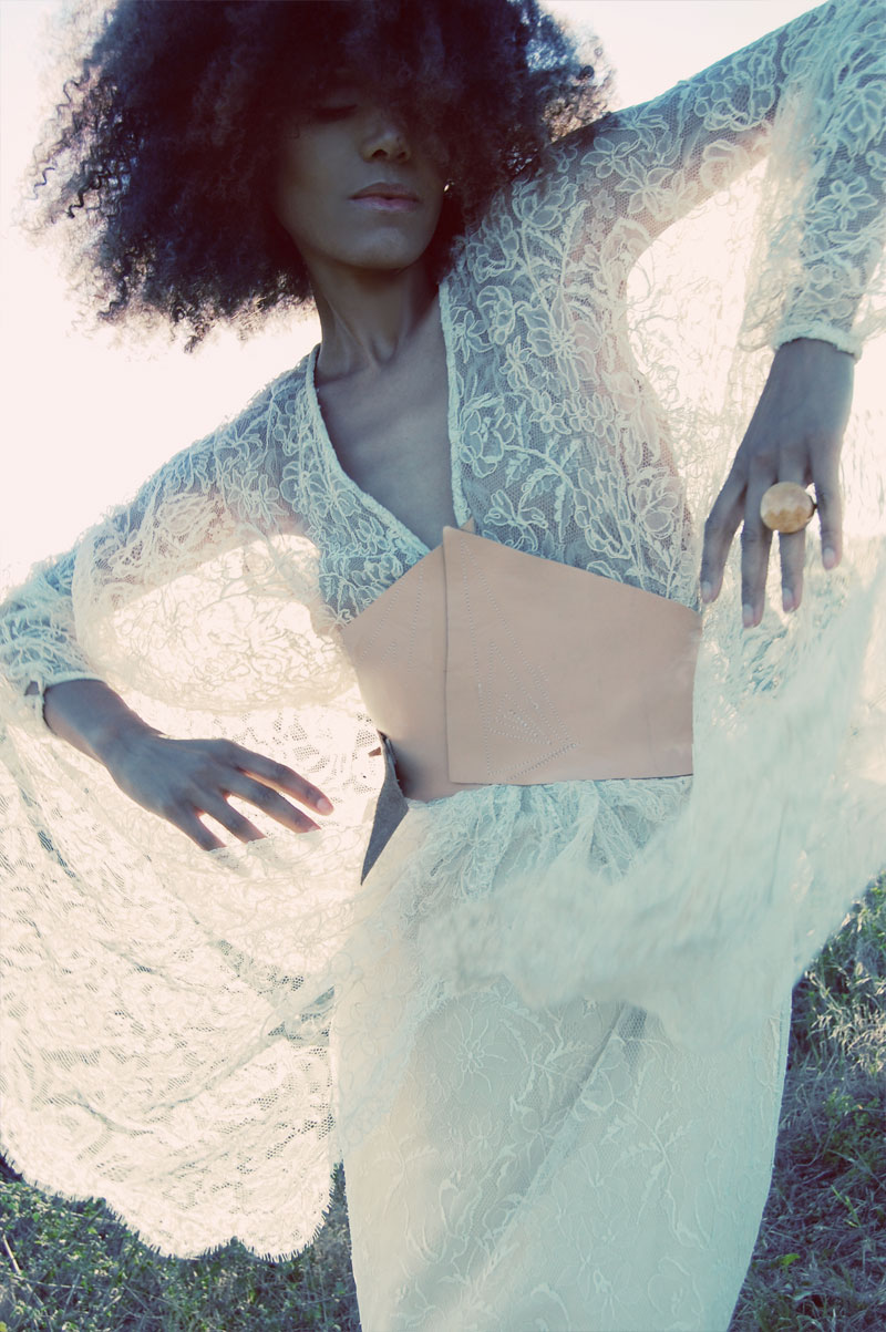 Ndoema wears a vintage lace dress and leather corset belt.