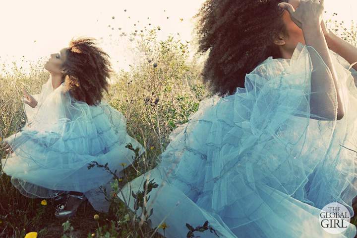 The Global Girl Fashion Editorials: In this fairy tale inspired photoshoot, Ndoema limbers up for a dance in in a fairy tale worthy vintage blue tulle dress, Calvin Klein peep toe sandals and her trademark big natural hair.