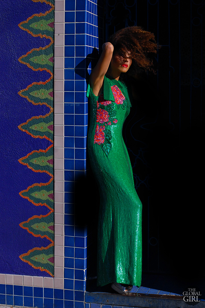The Global Girl Fashion Editorials: Ndoema sports an Asian-inspired emerald green sequin evening dress with hand-beaded rose embellishment by African fashion designer Mimi Plange.