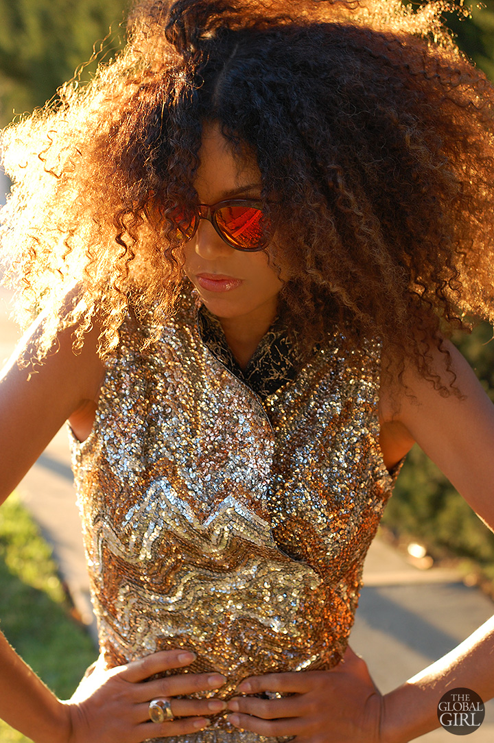 The Global Girl Daily Style: Ndoema sports the all-gold look in a vintage gold and silver sequin top and Le Specs cat eye mirrored sunglasses.