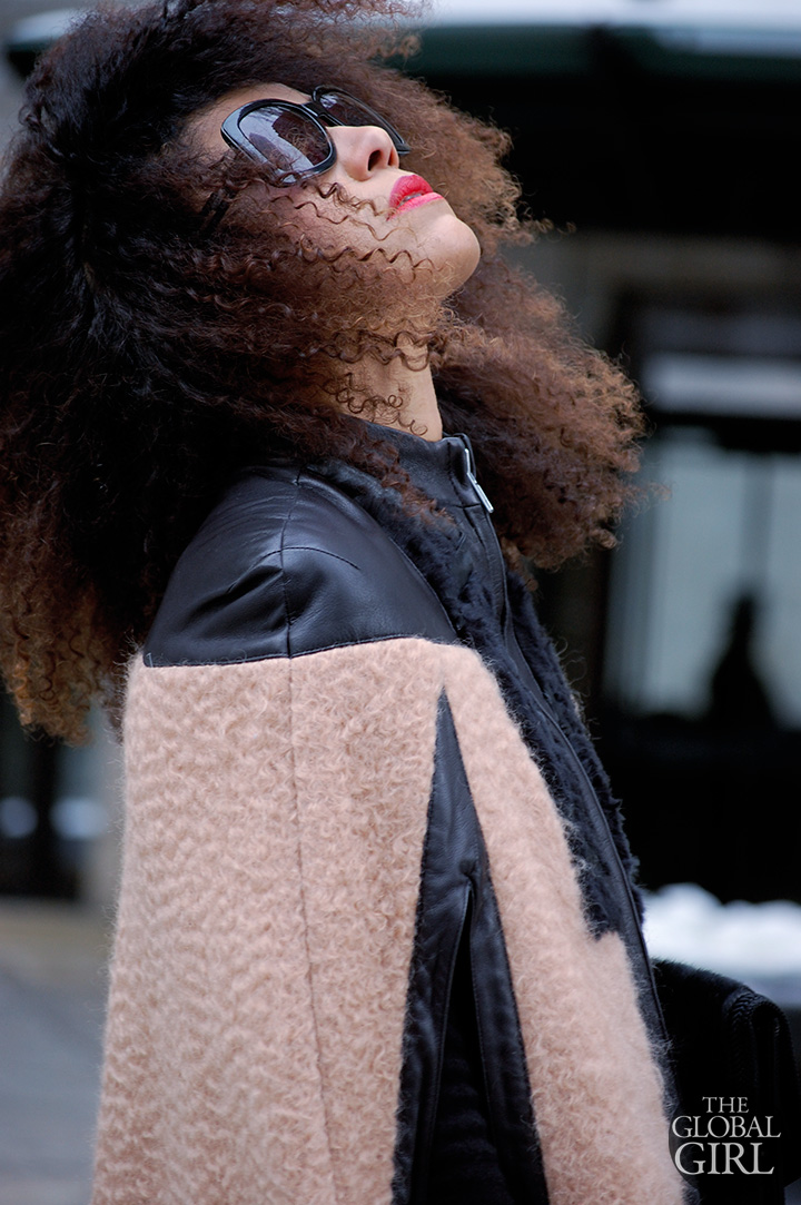 The Global Girl Daily Style: Ndoema rocks the winter cape look during New York Fashion Week in a wool and leather cape with leggings by Mimi Plange, Emanuel Ungaro bag, vintage leather gloves and Chloe sunglasses.